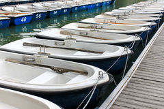 Blue row boats Stock Images