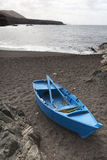 Blue rowing boat on the beach Royalty Free Stock Image