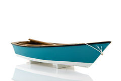 Blue rowing boat. Blue miniature rowing boat isolated over white background Stock Photography