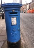 Blue royal mail post box in Manchester. royalty free stock image