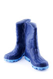 Blue rubber boots. Isolated on white background Stock Photos