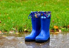 Blue rubber boots Stock Photography