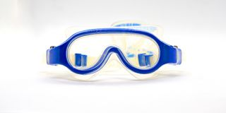 Blue rubber half plastic tranparent goggles for kid on  Royalty Free Stock Photography
