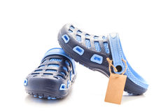 Blue rubber sandals shoes with  small brown tag,price tag, sale Stock Photo