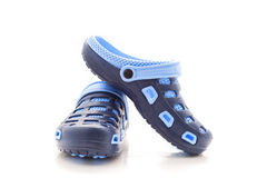 Blue rubber  sandals  shoes on a white background. Stock Image