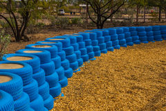 Blue Rubber Tires Used As Bumpers For Small Children at Desert P Royalty Free Stock Photos