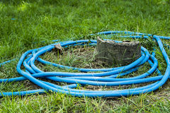 Blue rubber tube. A blue rubber tube for watering in the yard Stock Images