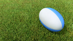 Blue rugby ball on grass V01. 3D blue rugby ball on grass V01 Royalty Free Stock Images