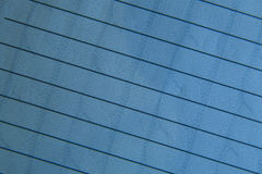 Blue ruled paper w/design Stock Photography