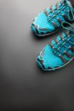 Blue running shoes on grey Royalty Free Stock Image