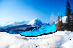 Blue running shoes Stock Images