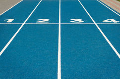 Blue running track. Empty startline at blue running track royalty free stock images