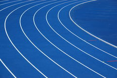 Blue running track. Lanes of blue university running track Royalty Free Stock Photo