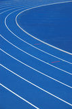 Blue running track. Lanes of blue university running track Stock Photo
