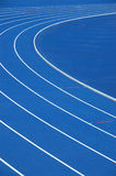 Blue running track. Lanes of blue running track Stock Photos