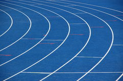 Blue running track Stock Image