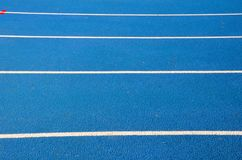 Blue running track on athletic stadium Royalty Free Stock Images