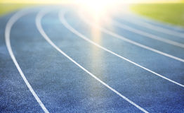 Blue running track stock photo