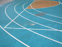 Blue running track Stock Photography
