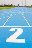 Blue running track Stock Images