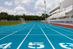 Blue running track Stock Photos