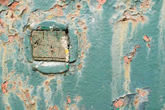 Blue rust metal plate with square wood piece. Rusted metal piece with green paint. Old wood piece in the middle. Construction royalty free stock images