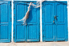 Blue rustic old door in fishing storages in Essauoira fishing po. Rt, Morocco. Vertical panoramic view Stock Photography