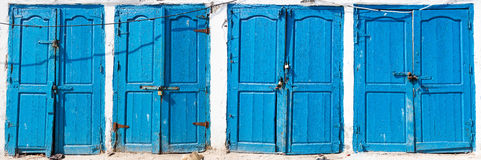 Blue rustic old door in fishing storages in Essauoira fishing po. Rt, Morocco. Vertical panoramic view Royalty Free Stock Image