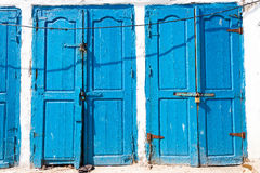 Blue rustic old door in fishing storages in Essauoira fishing po. Rt, Morocco. Vertical panoramic view Stock Photo
