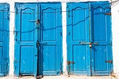 Blue rustic old door in fishing storages in Essauoira fishing po Stock Photo