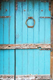 Blue rustic wooden door. With old style knocker Stock Photo