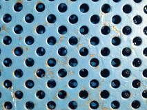 Blue rusty metal grate texture with holes close. This blue grate is part of a bike locker. I thought it had great texture Royalty Free Stock Image