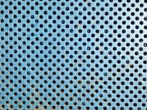 Blue rusty metal grate texture with holes close Stock Photo