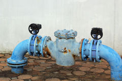 Blue rusty metal industrial water pipes with a valve. Stock Photography