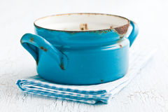 Blue rusty pot. On checkered napkin Stock Images