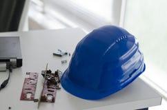 Blue safety helmet Stock Image