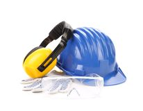 Blue safety helmet with earphones and goggles. Stock Photos
