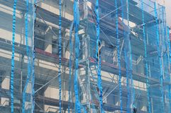 Blue safety net at scaffold Royalty Free Stock Photos