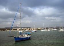 Blue Sailboat 3. Blue sailboat in the Porto Colom Bay of Majorca (Balearic Islands Royalty Free Stock Photography