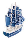 Blue sailboat with blue sails Royalty Free Stock Photo