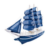 Blue sailboat with blue sails Stock Photography