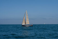Blue sailboat off San Diego Stock Image