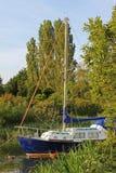Blue sailboat at river frome, wareham Stock Image