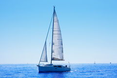 Blue sailboat sailing mediterranean sea Stock Photo