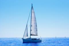 Blue sailboat sailing mediterranean sea Stock Photo