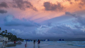 Blue sailboats at the famous Boracay island sunset to the white beach. 4K TimeLapse - August 2016, Boracay, Philippines stock video footage