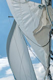Blue Sailing. Sails and ropes (Detail) on blue cloudy sky Stock Photos