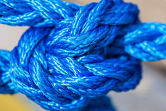 Blue sailing rope tied with knots Stock Images