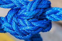 Blue sailing rope tied with knots Royalty Free Stock Photography