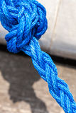 Blue sailing rope tied with knots. Shipping objects concept. Blue strong sailing ropes tied with knot. Outdoor shot on sunny day stock photography